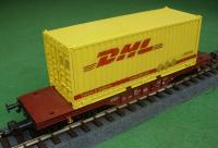 DB Flachwagen mit (Flat car with) 20' Container DHL ax904492